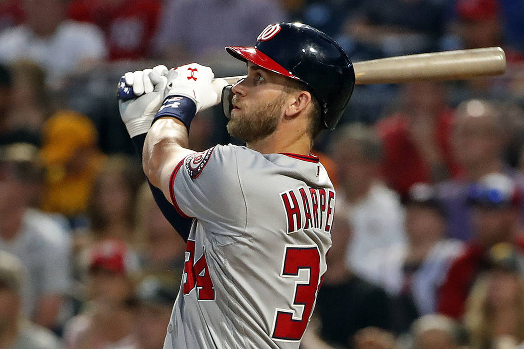 Washington Nationals' Bryce Harper watches his solo home run off Pittsburgh Pirates starting pitcher Ivan Nova in the sixth inning of a baseball game in Pittsburgh, Monday, July 9, 2018. (AP Photo ...