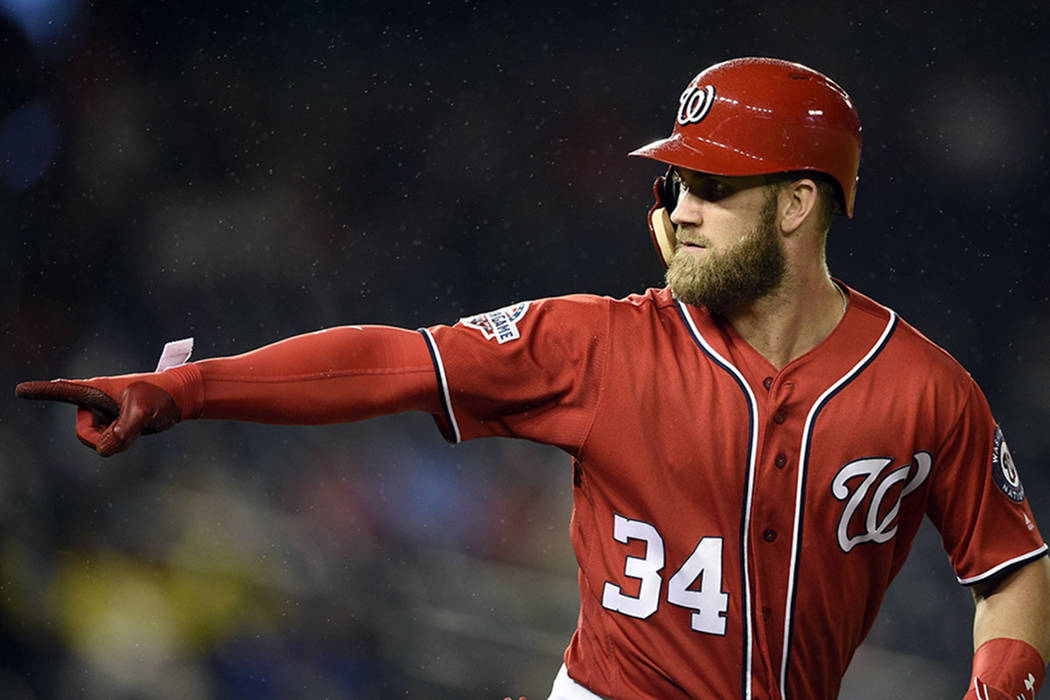Washington Nationals' Bryce Harper pointing to the dugout after he hit a home run against the Chicago Cubs in Washington in September 2018. (AP Photo/Nick Wass)