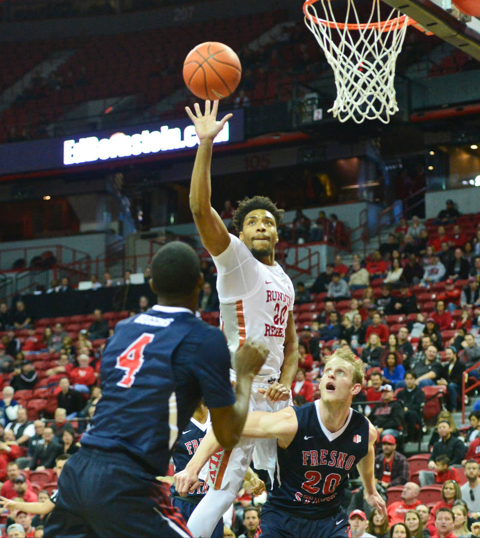 UNLV Rebels forward Nick Blair (20) goes for a rebound over Fresno State Bulldogs forward Sam Bittner (20) and guard Braxton Huggins (4) during the second half of a game between UNLV and Fresno St ...