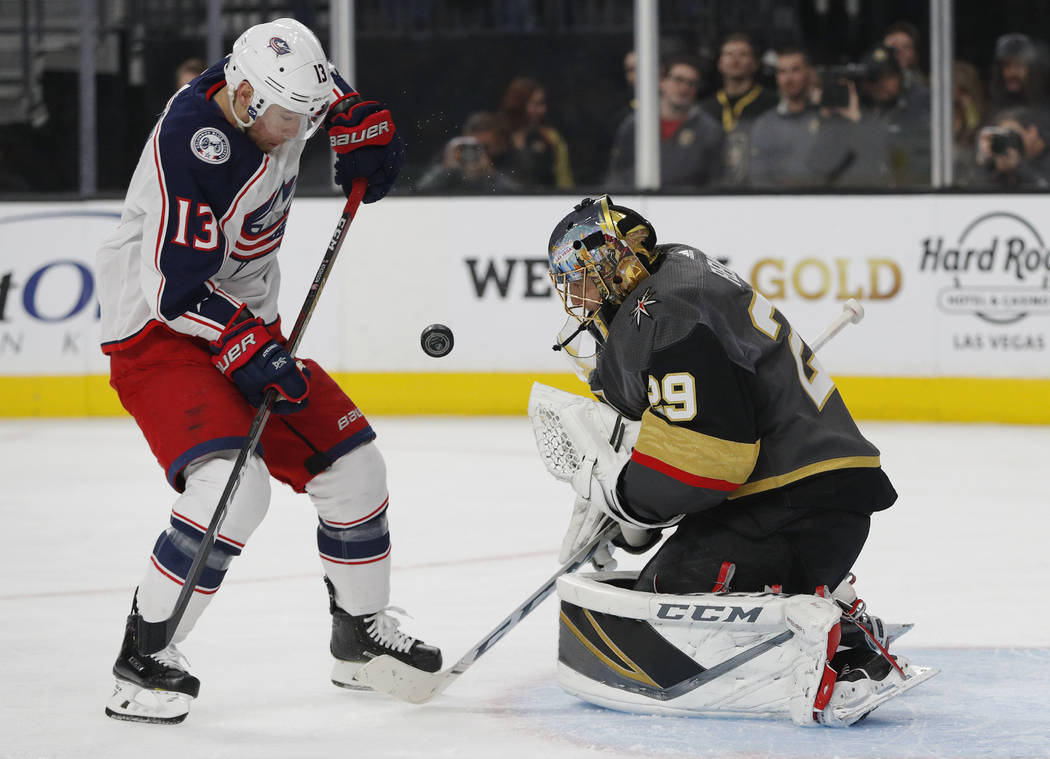 Columbus Blue Jackets right wing Cam Atkinson (13) shoots on Vegas Golden Knights goaltender Marc-Andre Fleury (29) during the first period of an NHL hockey game Saturday, Feb. 9, 2019, in Las Veg ...