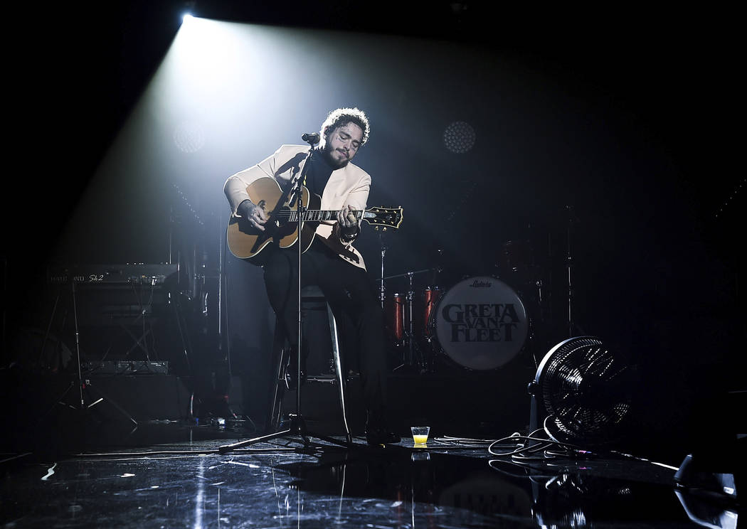 In this photo provided by Universal Music Group, Post Malone performs at Sir Lucian Grainge's 2019 Artist Showcase Presented by Citi on Saturday, Feb. 9, 2019 in Los Angeles. Universal Music Group ...