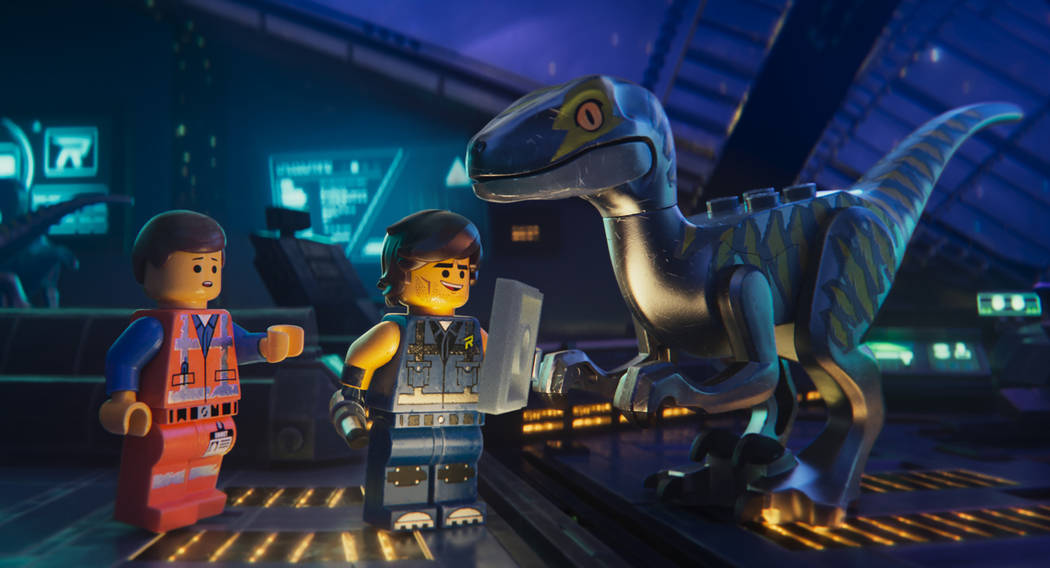 "This image released by Warner Bros. Pictures shows the characters Emmet, left, and Rex Dangervest, center, both voiced by Chris Pratt, in a scene from ""The Lego Movie 2: The Second Part.&quot ..."