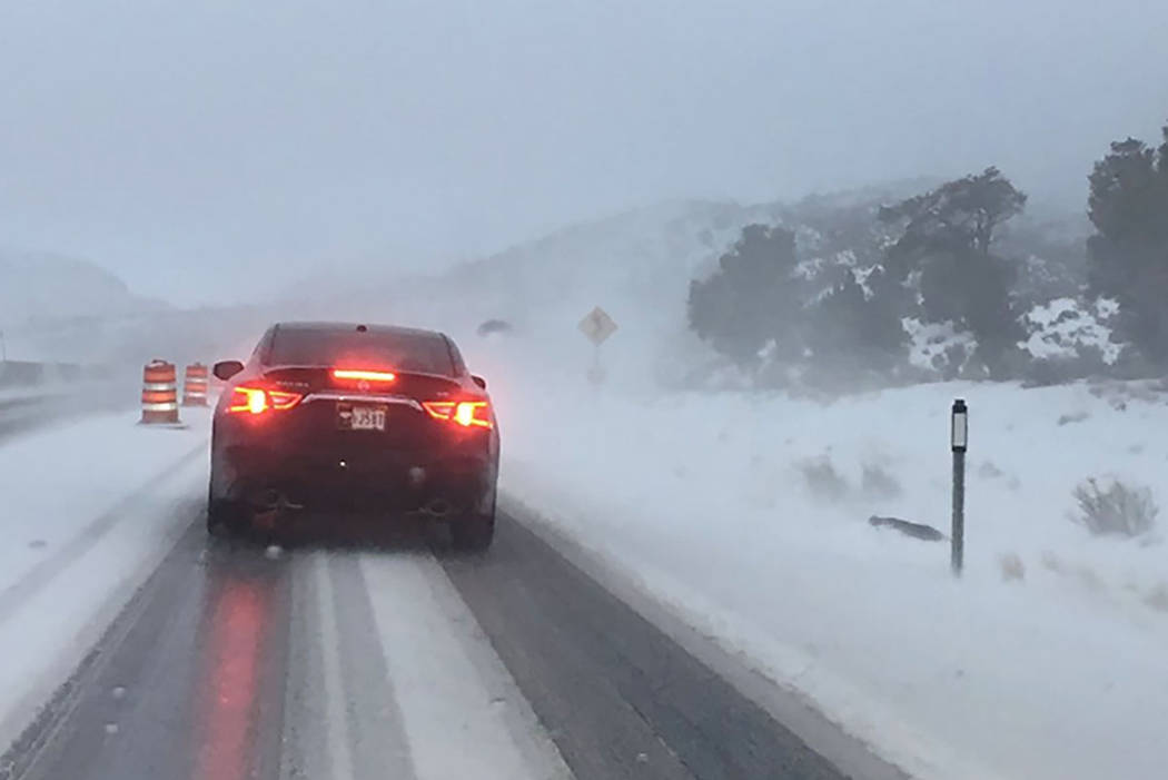 Motorists travel State Route 160 in a snowstorm near Mountain Springs, about 30 miles west of Las Vegas, on Sunday, Feb. 10, 2019. (Mick Akers/Las Vegas Review-Journal)