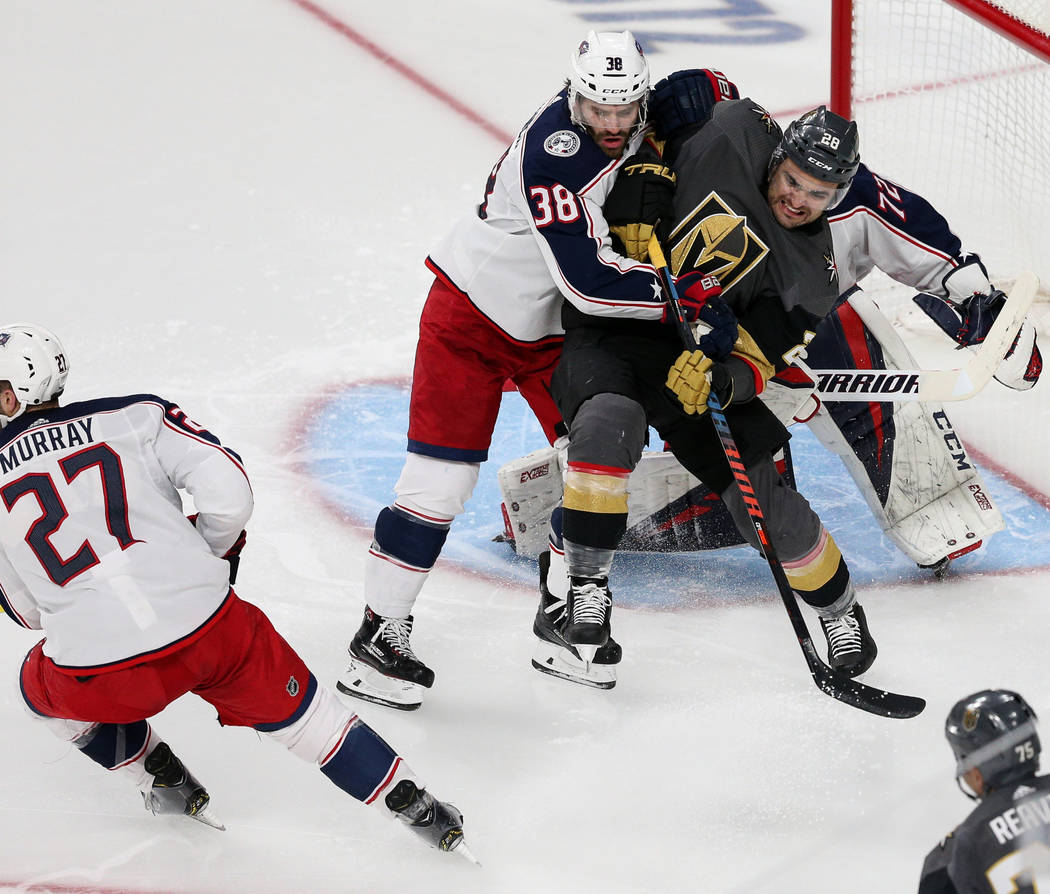 Columbus Blue Jackets center Boone Jenner (38) and Vegas Golden Knights left wing William Carrier (28) push each other on the ice during the second period of an NHL hockey game at T-Mobile Arena i ...