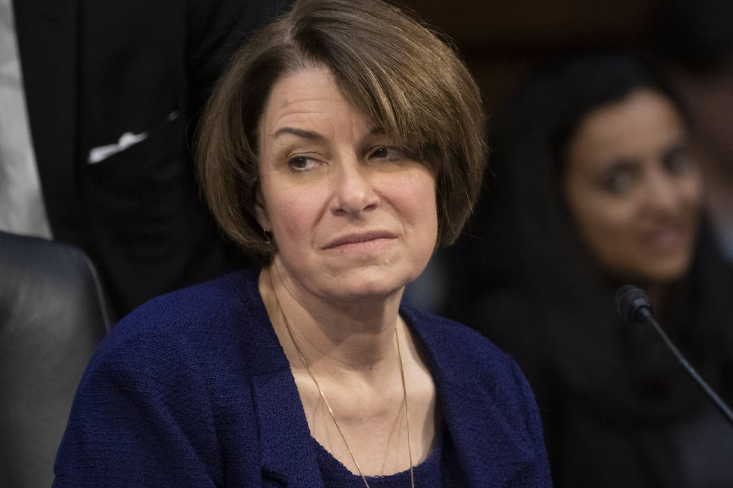 Senate Judiciary Committee member Sen. Amy Klobuchar, D-Minn., prepares to vote against advancing William Barr's nomination for attorney general, as the panel meets on Capitol Hill in Washington, ...