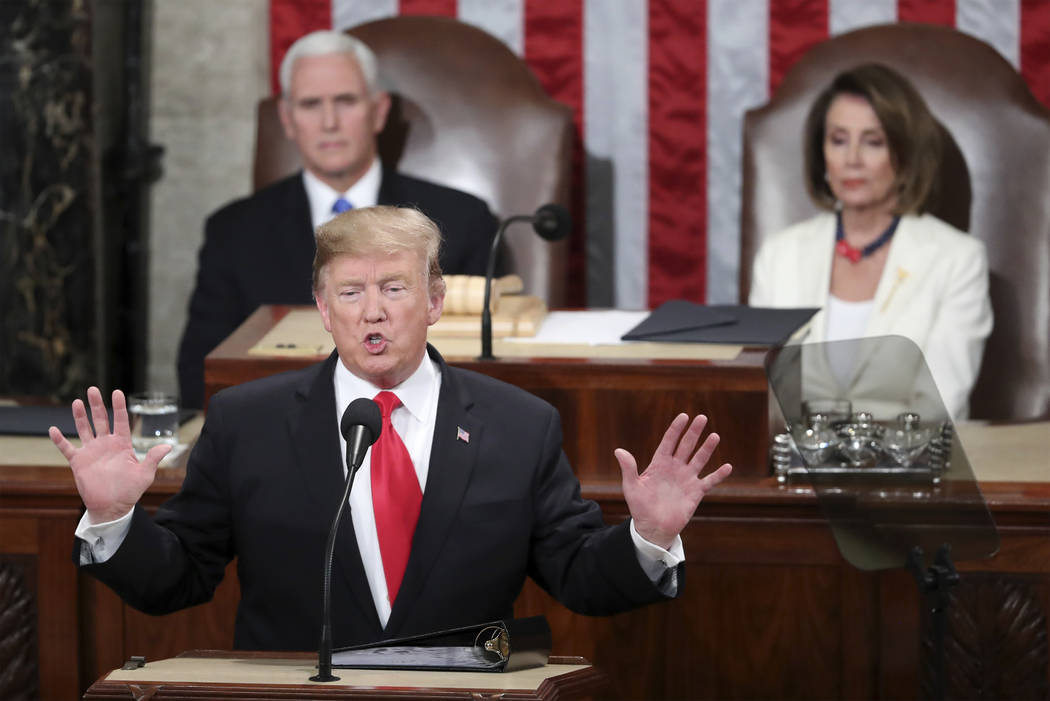 In this Feb. 5, 2019 photo, President Donald Trump delivers his State of the Union address to a joint session of Congress on Capitol Hill in Washington, as Vice President Mike Pence and Speaker of ...