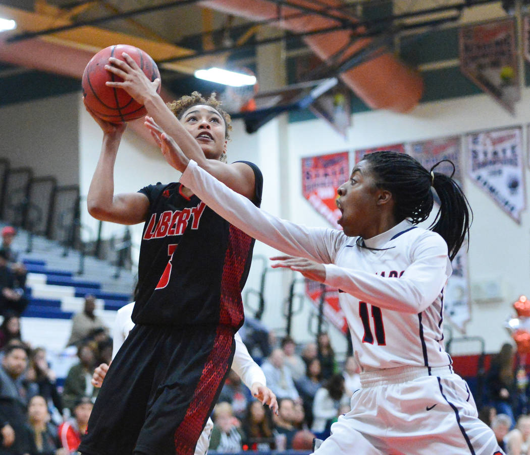 Liberty senior Journie Augmon (3) takes a shot over Coronado Senior Tia Thornton (11) in the third quarter of a game between Coronado High School and Liberty High School at Coronado High School in ...