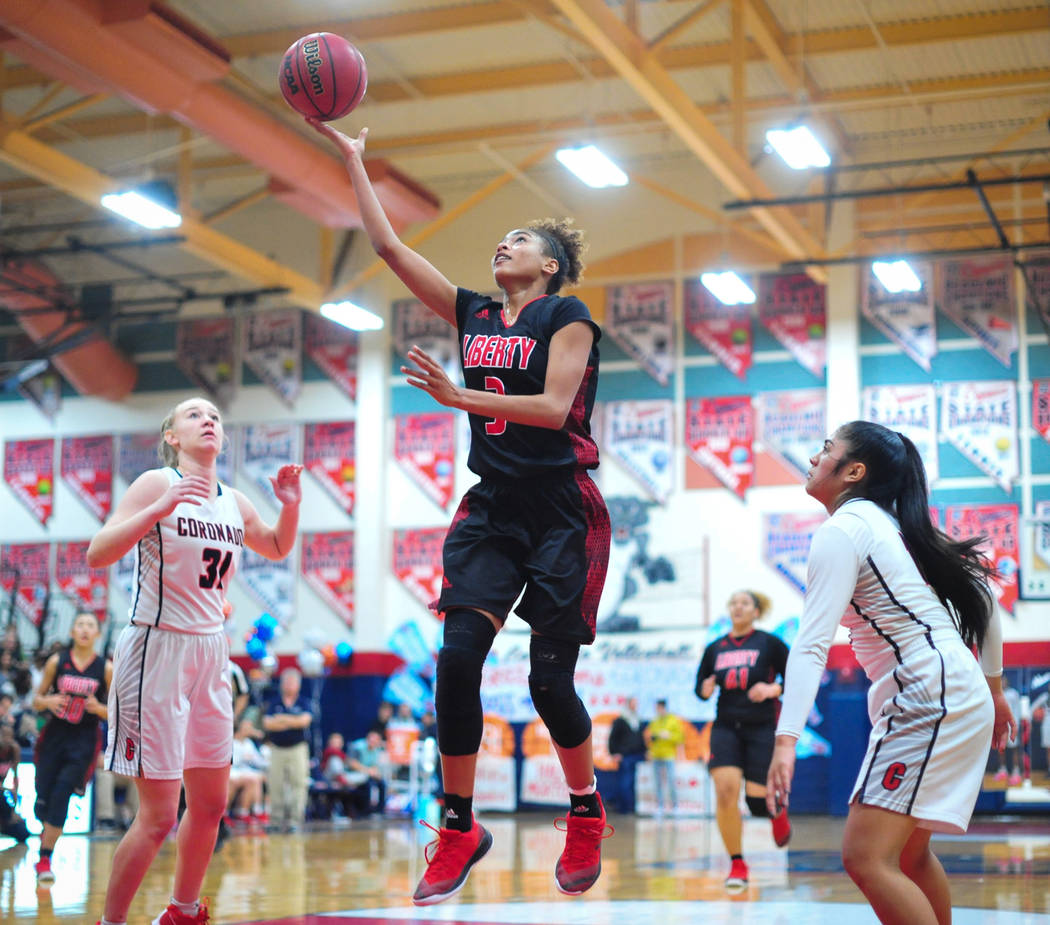 Liberty senior Journie Augmon (3) shoots a layup during the third quarter of a game between Coronado High School and Liberty High School at Coronado High School in Henderson, Nev., on Friday, Feb. ...