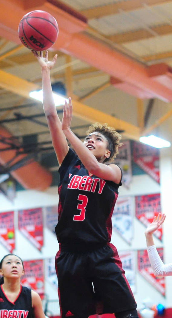 Liberty senior Journie Augmon (3) takes a shot during the fourth quarter of a game between Coronado High School and Liberty High School at Coronado High School in Henderson, Nev., on Friday, Feb. ...