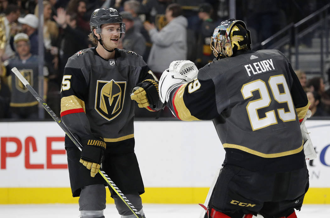 Vegas Golden Knights defenseman Jon Merrill, left, celebrates with goaltender Marc-Andre Fleury after Merrill scored against the Columbus Blue Jackets during the first period of an NHL hockey game ...