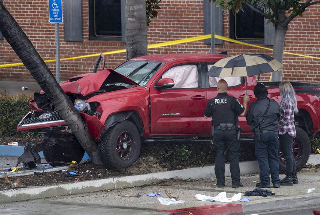 Fullerton Police investigate an early-morning accident that injured several pedestrians, Sunday, Feb. 10, 2019, in Fullerton, Calif. (Mindy Schauer/The Orange County Register via AP)