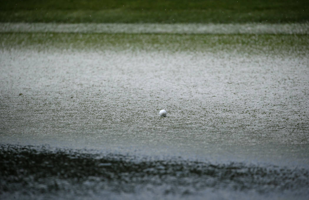 The ball of Scott Langley is surrounded by hail on the second green of the Pebble Beach Golf Links during the final round of the AT&T Pebble Beach Pro-Am golf tournament Sunday, Feb. 10, 2019, ...