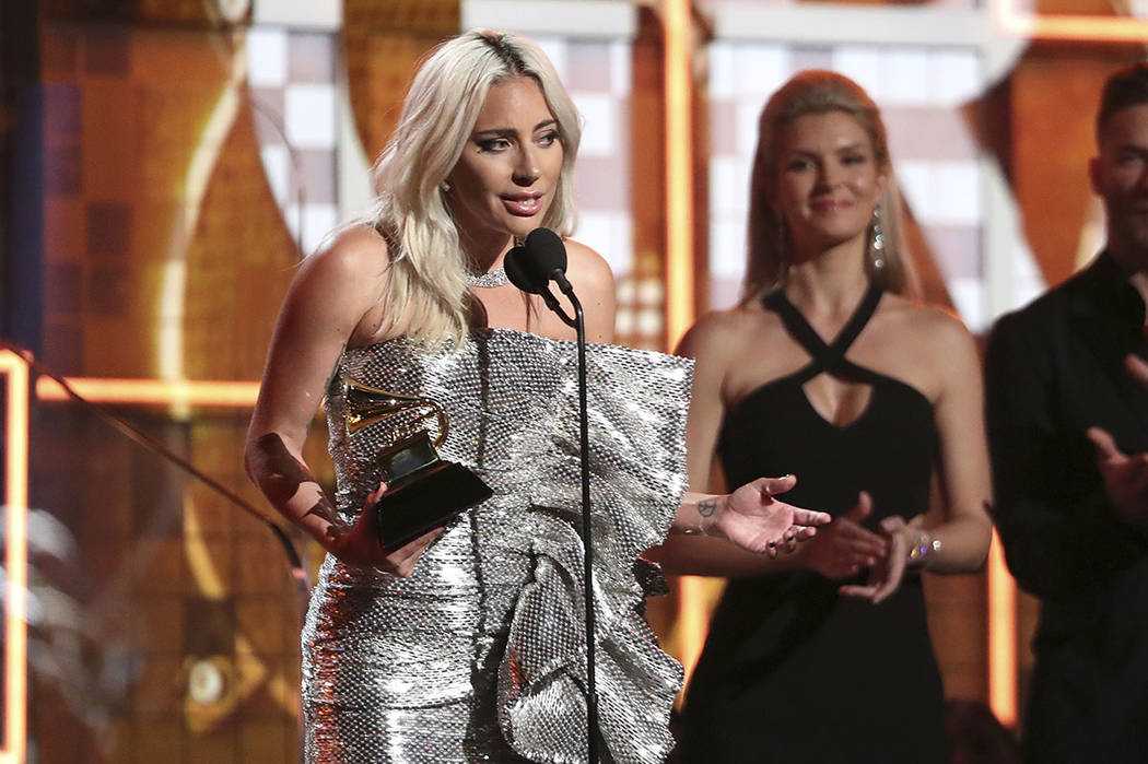 "Lady Gaga accept the award for best pop duo or group performance for ""Shallow"" at the 61st annual Grammy Awards on Sunday, Feb. 10, 2019, in Los Angeles. (Photo by Matt Sayles/Invision/AP)"
