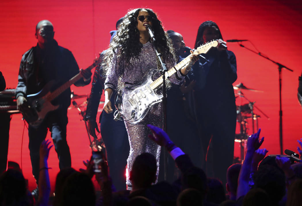 """H.E.R. performs """"Hard Place"""" at the 61st annual Grammy Awards on Sunday, Feb. 10, 2019, in Los Angeles. (Photo by Matt Sayles/Invision/AP)"""