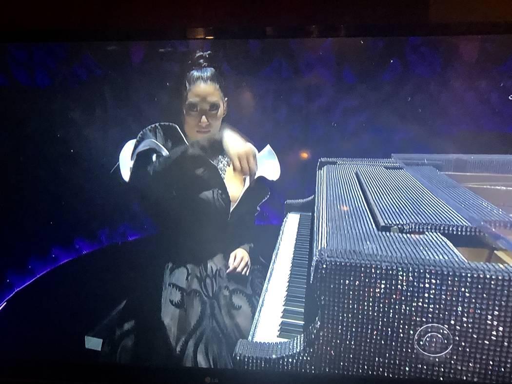 A screen grab of Chloe Flower playing Liberace's rhinestone Baldwin during CBS's Grammy Awards telecast on Sunday, Feb. 10, 2019. John Katsilometes/Las Vegas Review-Journal @Johnny Kats