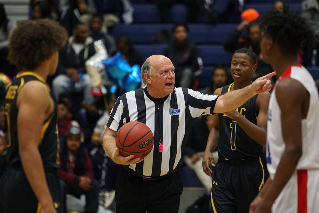 Basketball official Neil Gallant talks with players during a game at Democracy Prep at Agassi Academy Campus in Las Vegas, Monday, Feb. 11, 2019. Caroline Brehman/Las Vegas Review-Journal