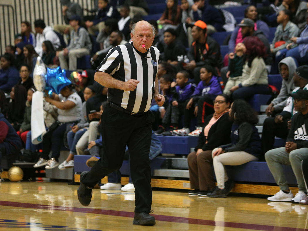 Basketball official Neil Gallant runs down the court during a game at Democracy Prep at Agassi Academy Campus in Las Vegas, Monday, Feb. 11, 2019. Caroline Brehman/Las Vegas Review-Journal