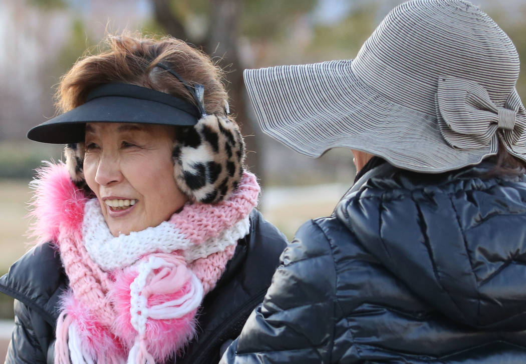 Yoko Fitzgerald, left, and Gina Kim, all of Henderson, bundled up as they walk along Seven Hills Drive during a cold morning on Monday, Feb. 11, 2019, in Henderson. (Bizuayehu Tesfaye/Las Vegas Re ...