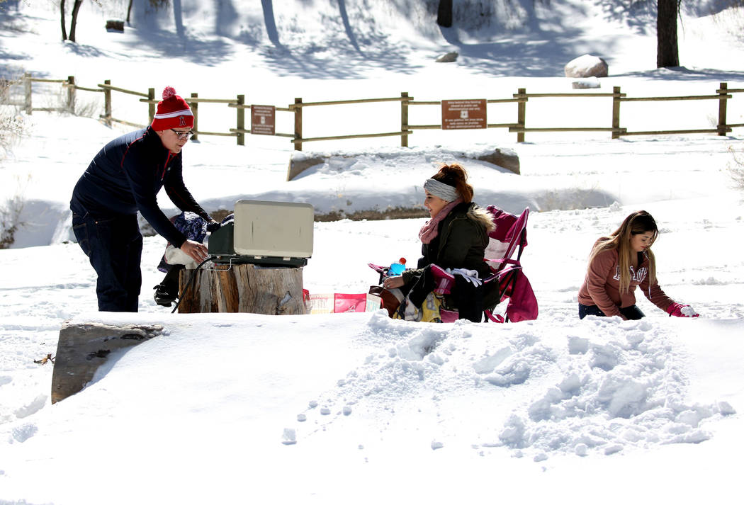 Ricky Villanueva, left, his sister Yanelie and his wife, Dayana, enjoy their picnic at Mount Charleston north of Las Vegas on Monday, Feb. 11, 2019, in Las Vegas. (Bizuayehu Tesfaye/Las Vegas Revi ...