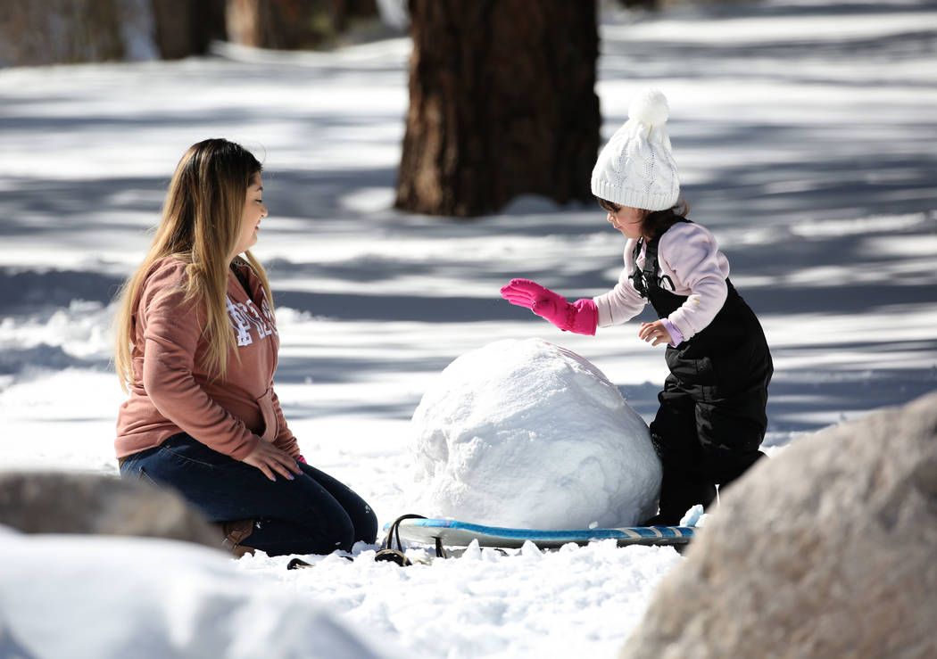 Dayana Villanueva plays with her daughter Carolynn, 3, at Mount Charleston north of Las Vegas on Monday, Feb. 11, 2019, in Las Vegas. (Bizuayehu Tesfaye/Las Vegas Review-Journal) @bizutesfaye