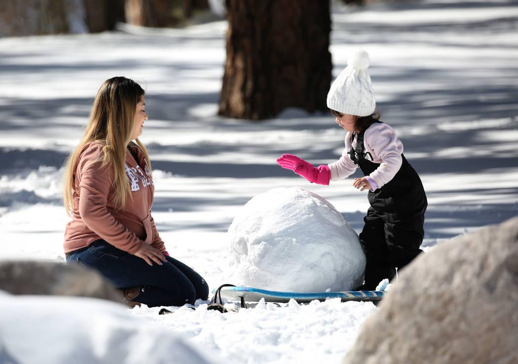 Dayana Villanueva plays with her daughter Carolynn, 3, at Mount Charleston north of Las Vegas on Monday, Feb. 11, 2019, in Las Vegas. (Bizuayehu Tesfaye/Las Vegas Review-Journal) @bizutesfaye