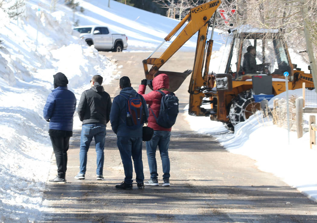 Residents watch as their street being plowed at Mount Charleston north of Las Vegas on Monday, Feb. 11, 2019, in Las Vegas. (Bizuayehu Tesfaye/Las Vegas Review-Journal) @bizutesfaye