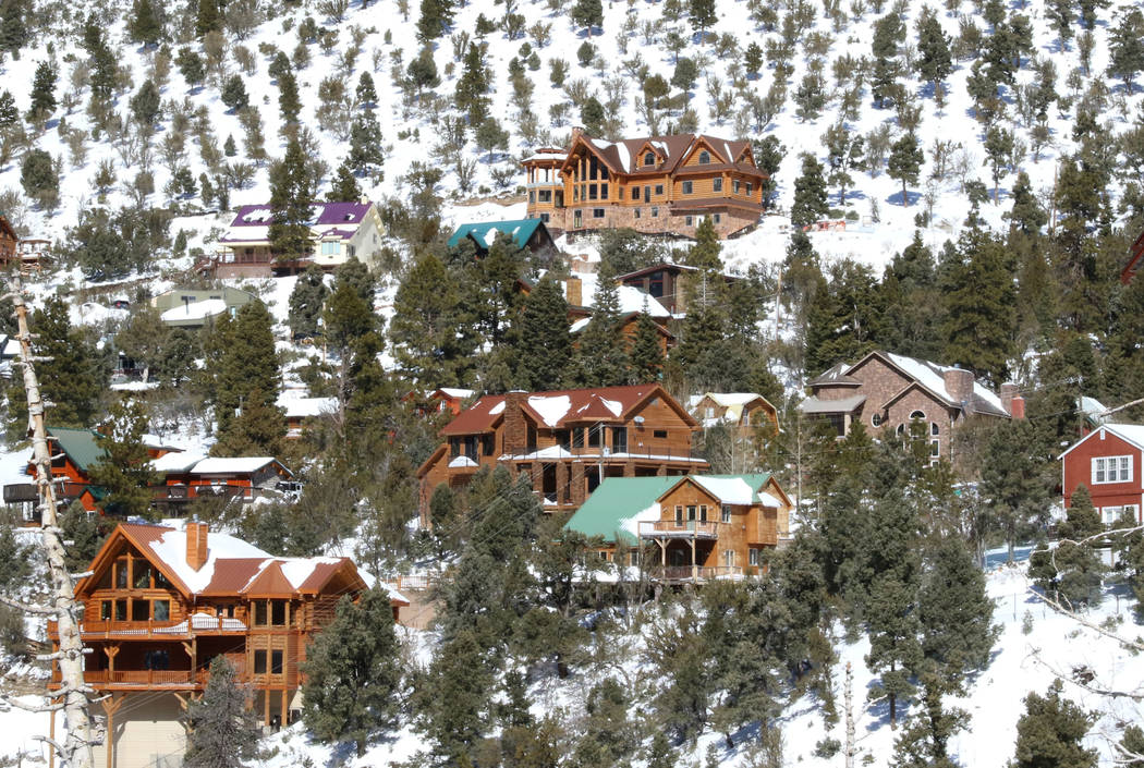 Cabins and houses are seen on snow-covered Mount Charleston on Monday, Feb. 11, 2019, in Las Vegas. (Bizuayehu Tesfaye/Las Vegas Review-Journal) @bizutesfaye
