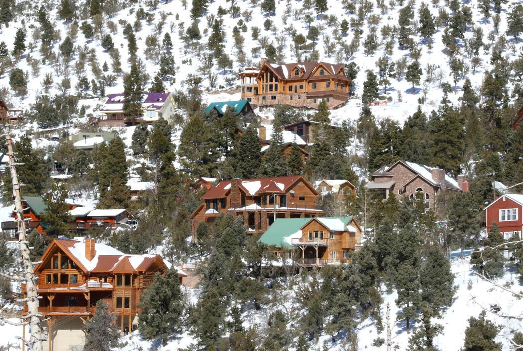 Cabins and houses are seen on snow-covered Mount Charleston on Monday, Feb. 11, 2019, in Las Vegas. (Bizuayehu Tesfaye/Las Vegas Review-Journal) @bizutesfaye