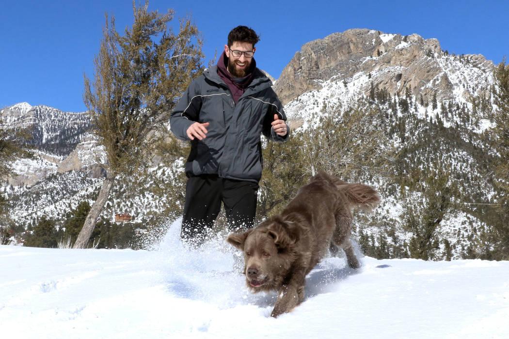 Levi White plays with his dog, Chewbacca, at Mount Charleston north of Las Vegas on Monday, Feb. 11, 2019. (Bizuayehu Tesfaye/Las Vegas Review-Journal) @bizutesfaye