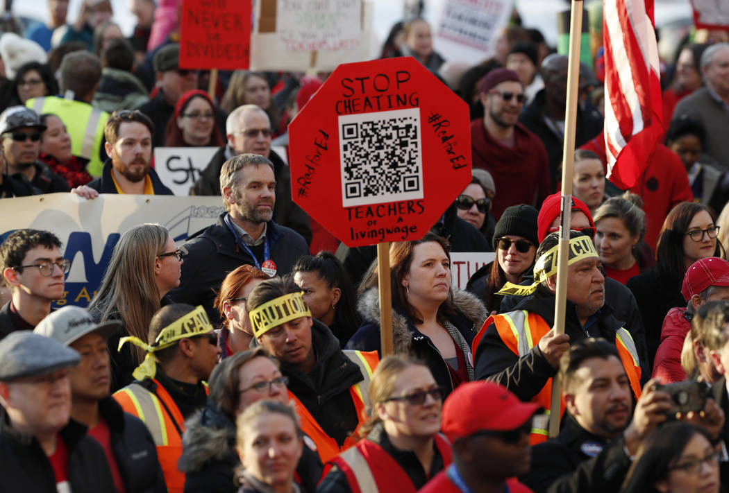 FILE - In this Jan. 30, 2019, file photo, Denver Public Schools teachers rally outside the State Capitol in Denver. Denver teachers are planning to strike Monday, Feb. 11, 2019 after failed negoti ...