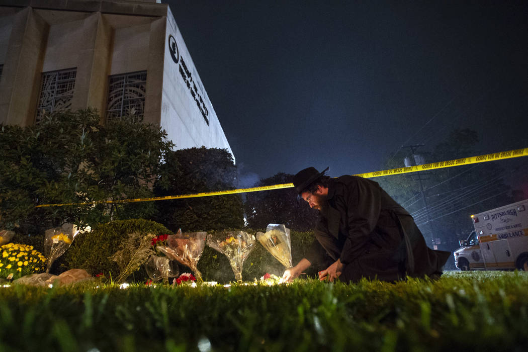Rabbi Eli Wilansky lights a candle after a mass shooting at Tree of Life Synagogue in Pittsburgh's Squirrel Hill neighborhood, Oct. 27, 2018. (Steph Chamber/Pittsburgh Post-Gazette via AP, File)