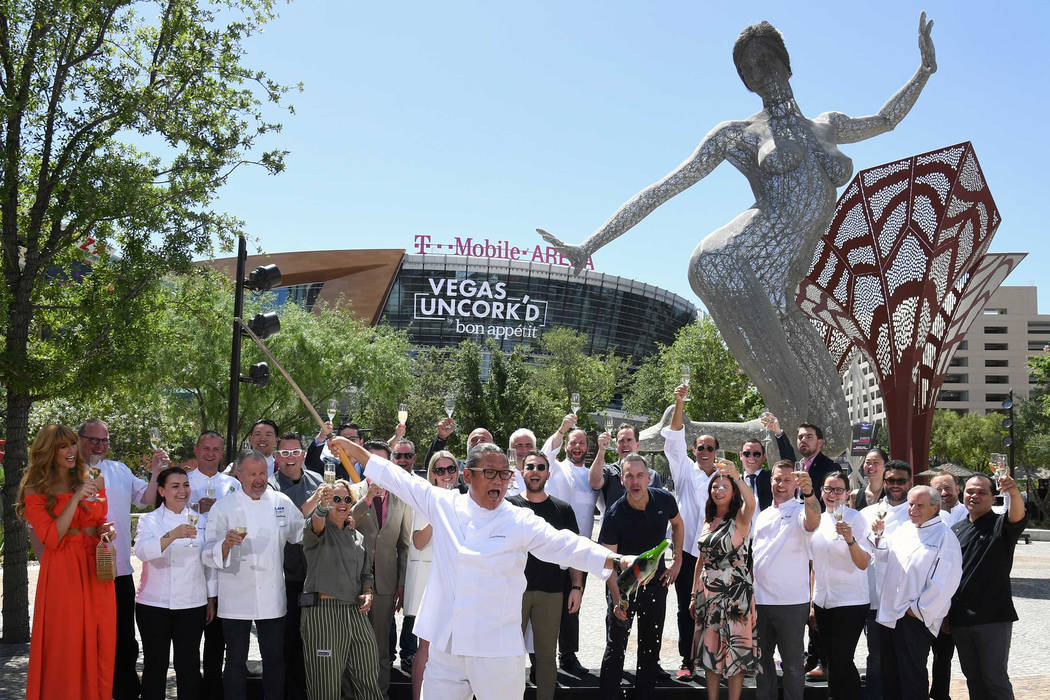 Surrounded by fellow star chefs, Masaharu Morimoto ceremoniously sabers a bottle of Prosecco at The Park on Thursday, May 11, 2018, officially launching the 12th annual Uncork'd by Bon Apetit. (Et ...