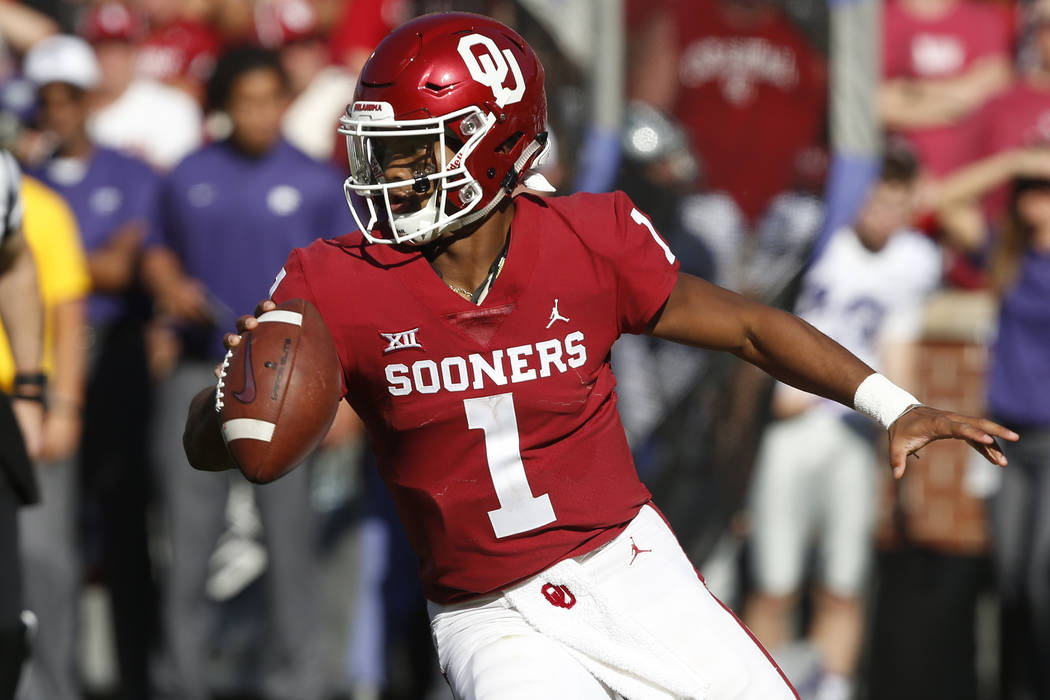 In this Oct. 27, 2018, file photo, Oklahoma quarterback Kyler Murray maneuvers during the team's NCAA college football game against Kansas State in Norman, Okla. (AP Photo/Sue Ogrocki, File)
