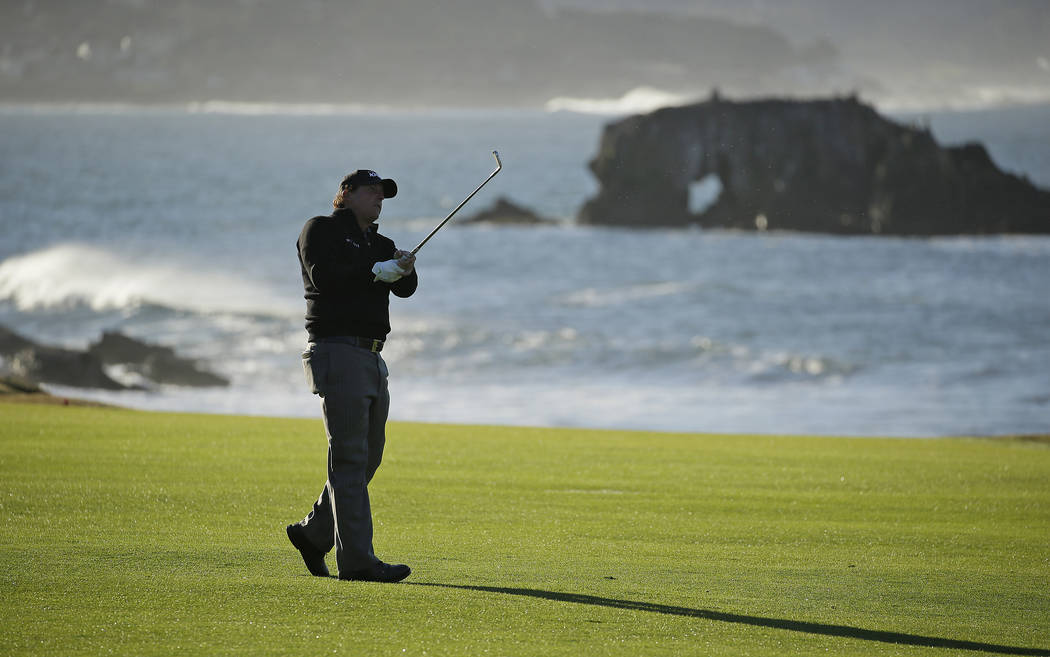 Phil Mickelson hits from the 18th fairway of the Pebble Beach Golf Links during the final round of the AT&T Pebble Beach Pro-Am golf tournament Monday, Feb. 11, 2019, in Pebble Beach, Calif. M ...