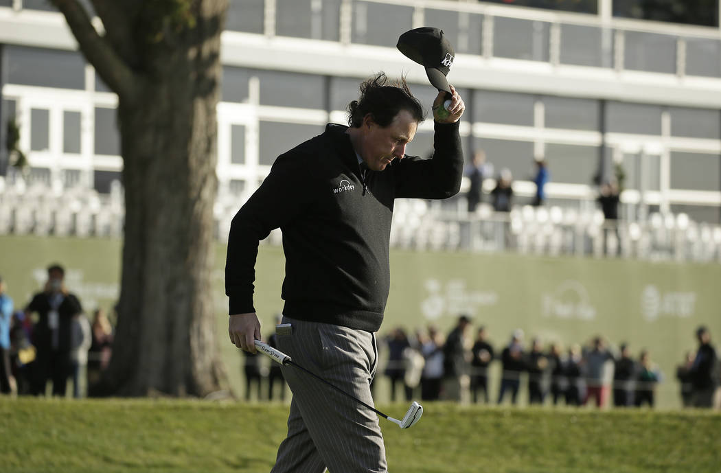 Phil Mickelson tips his hat on the 18th green of the Pebble Beach Golf Links after winning the AT&T Pebble Beach Pro-Am golf tournament Monday, Feb. 11, 2019, in Pebble Beach, Calif. (AP Photo ...