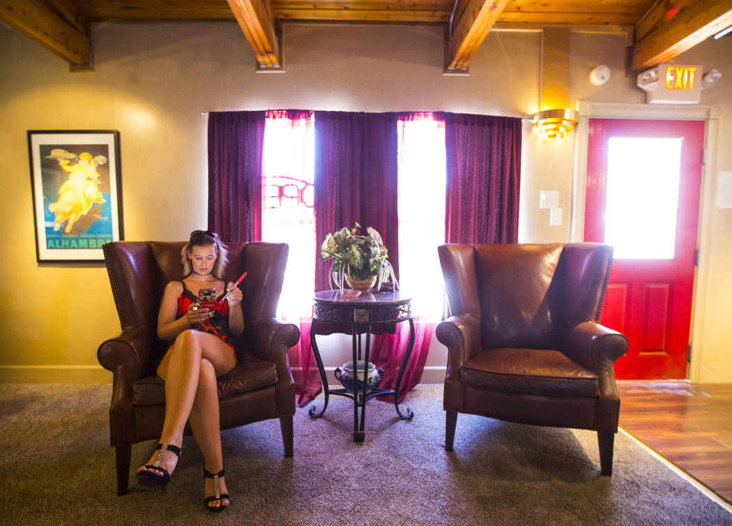 Prostitute Brooklyn Moore, left, uses her phone while waiting for clients at the Love Ranch brothel in Crystal, just north of Pahrump, on Friday, July 20, 2018. Chase Stevens Las Vegas Review-Jour ...