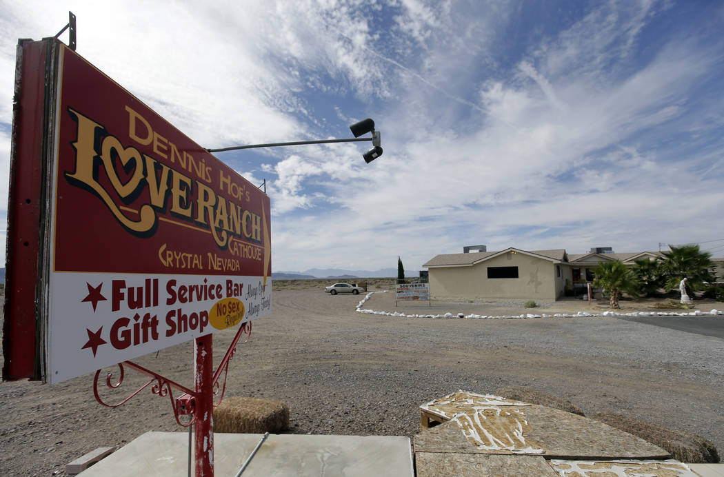 A sign advertises the Love Ranch brothel in Crystal, Nevada. (Chris Carlson/The Associated Press)