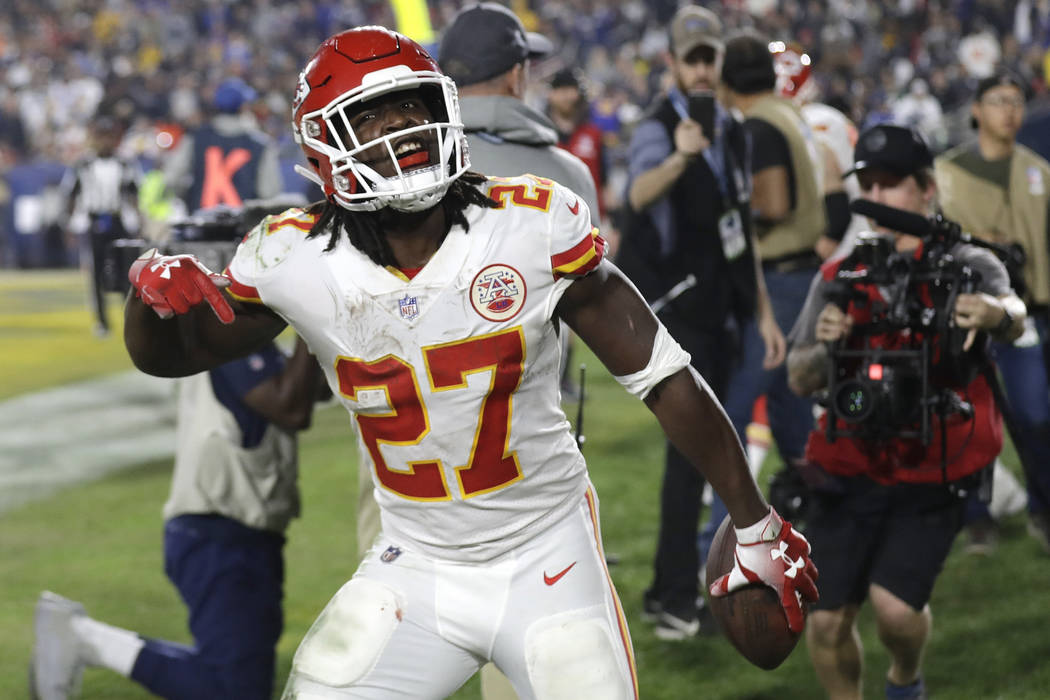 Kansas City Chiefs running back Kareem Hunt reacts after scoring a touchdown against the Los Angeles Rams during the first half of an NFL football game, Monday, Nov. 19, 2018, in Los Angeles. (AP ...