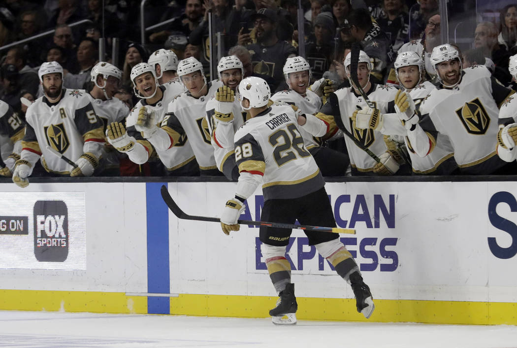 Vegas Golden Knights' William Carrier (28) celebrates with teammates after scoring against the Los Angeles Kings during the first period of an NHL hockey game Saturday, Dec. 29, 2018, in Los Angel ...