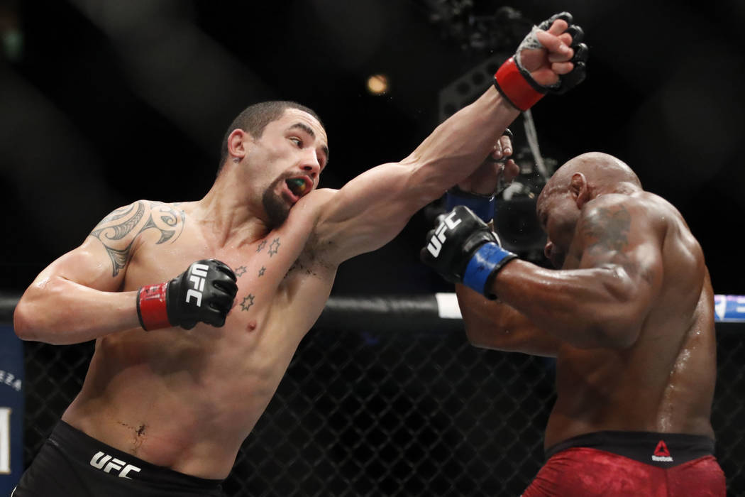 Robert Whittaker, left, and Yoel Romero fight during their title bout at the UFC 225 Mixed Martial Arts event Sunday, June 10, 2018, in Chicago. (AP Photo/Jim Young)