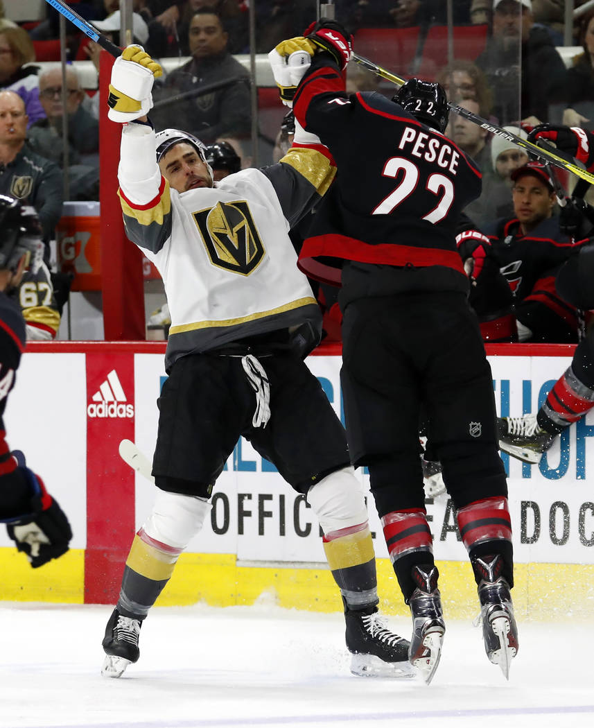 Carolina Hurricanes' Brett Pesce (22) collides with Vegas Golden Knights' Brandon Pirri (73) during the third period of an NHL hockey game Friday, Feb. 1, 2019, in Raleigh, N.C. (AP Photo/Karl B D ...