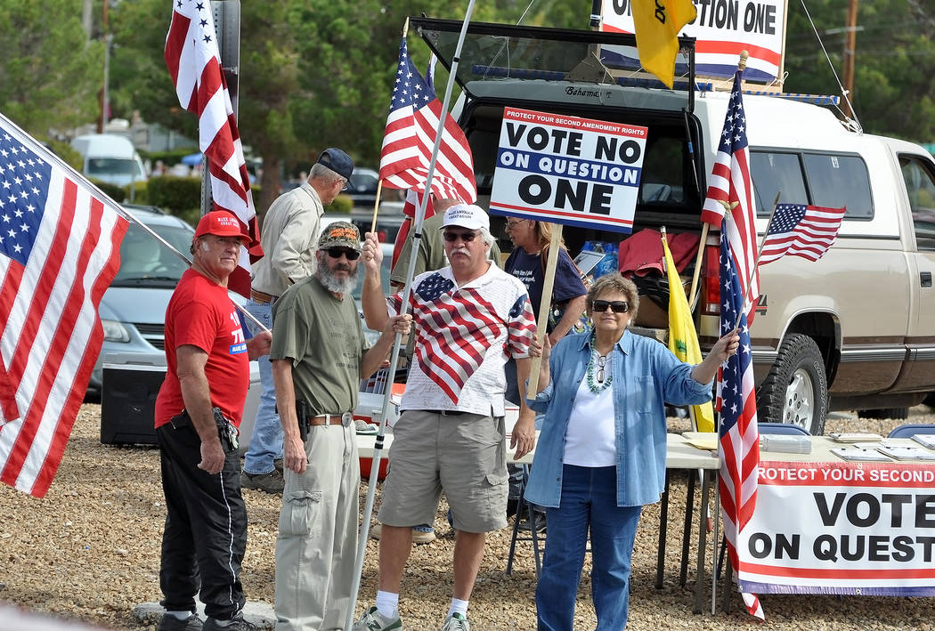 """A """"VOTE NO ON QUESTION 1"""" rally in Pahrump on Highway 160 in October. A new Nevada law requiring background checks for private party gun sales was deemed unenforceable Wednesday. Horace Langf ..."""