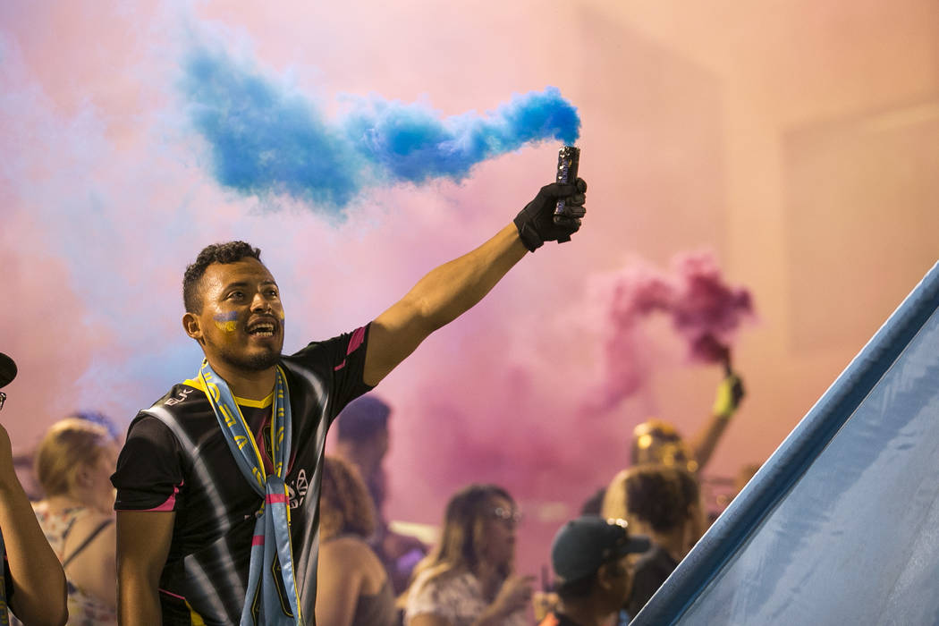 Las Vegas Lights FC fans light smoke grenades ahead of a United Soccer League soccer match against Fresno FC at Cashman Field in downtown Las Vegas on Saturday, August 25, 2018. Richard Brian La ...