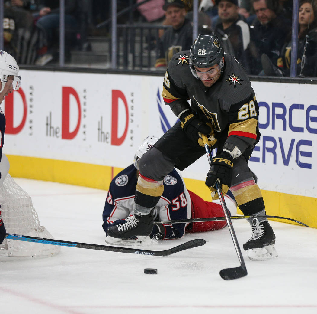 Vegas Golden Knights left wing William Carrier (28) rounds the Columbus Blue Jackets' goal with the puck during the third period of an NHL hockey game at T-Mobile Arena in Las Vegas, Saturday, Feb ...