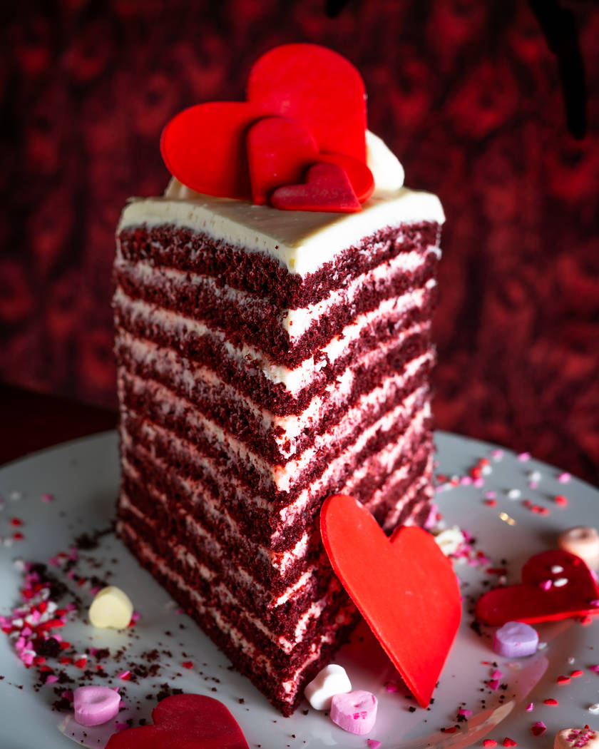 In Lavo's 20-layer red velvet cake, the cocoa-flavored, red-chocolate cake is interspersed with cream cheese-mascarpone frosting and decorated with hearts and sprinkles. (Lavo)
