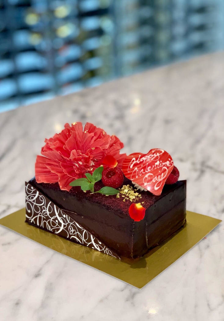 For the Valentine Special Cake at Sweets Raku, sponge cake is layered with chocolate and raspberry mousse, blanketed in ganache and decorated with a chocolate flower and heart, raspberries and ros ...