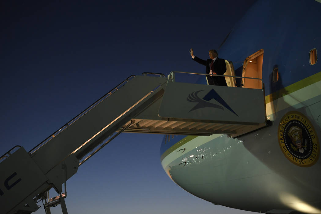 President Donald Trump walks down the steps of Air Force One at El Paso International Airport in El Paso, Texas, Monday, Feb. 11, 2019. (AP Photo/Susan Walsh)
