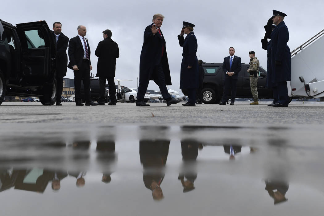 President Donald Trump waves as he arrives to board Air Force One at Andrews Air Force Base in Md., Monday, Feb. 11, 2019. Trump is heading to El Paso, Texas, to try and turn the debate over a wal ...