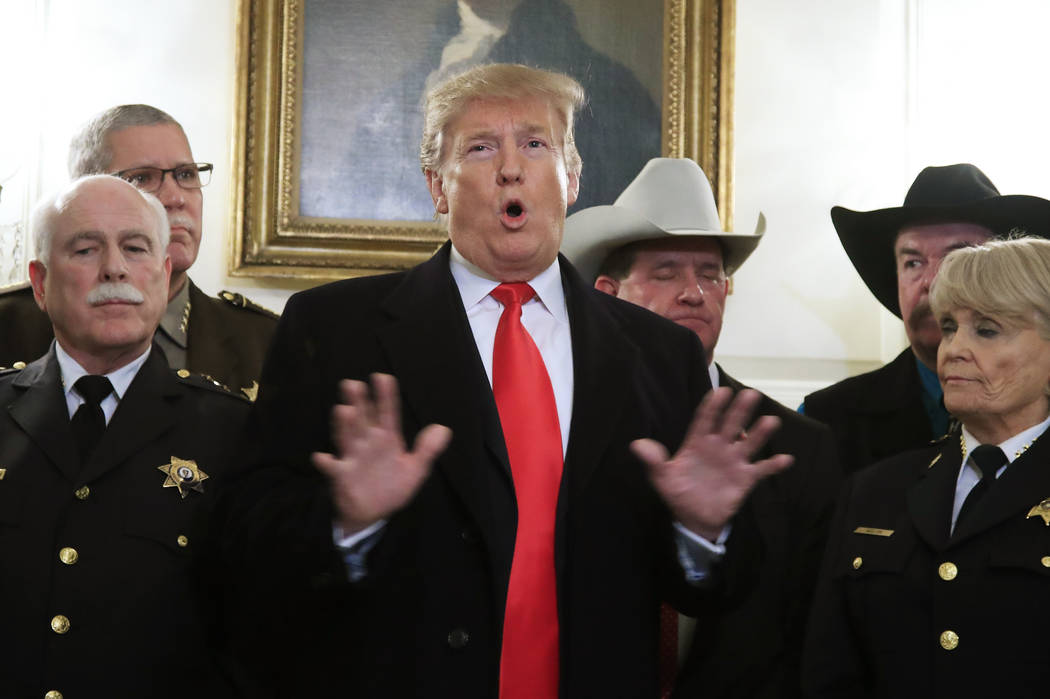 President Donald Trump speaks during a meeting with a group of sheriffs from around the country before leaving the White House in Washington, Monday, Feb. 11, 2019, for a trip to El Paso, Texas. ...