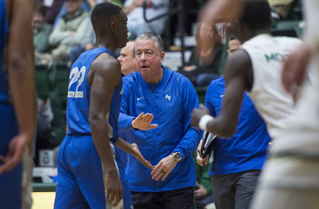 Air Force coach Dave Pilipovich encourages guard Pervis Louder during a timeout in the team's NCAA college basketball game against Colorado State on Tuesday, Jan. 8, 2019, at Moby Arena in Fort Co ...
